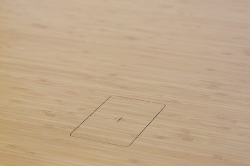 Mid brown bamboo wireless charging outline